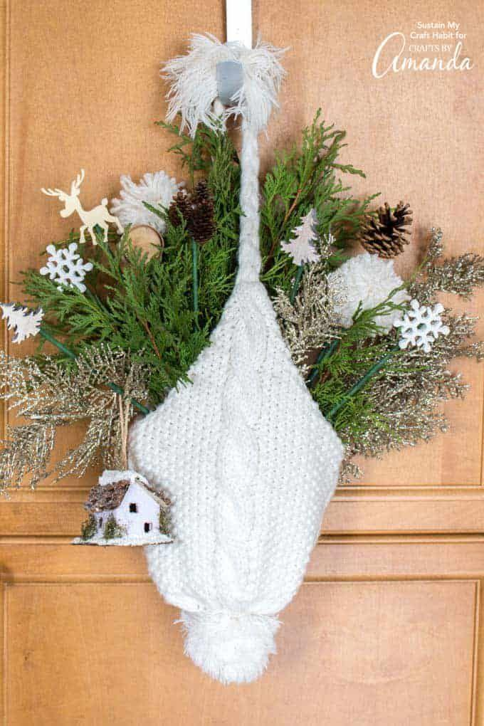 """<p>Yes, you read that right. This door décor was made using a winter hat!</p><p><strong>Get the tutorial at <a href=""""https://craftsbyamanda.com/winter-hat-door-hanging/"""" rel=""""nofollow noopener"""" target=""""_blank"""" data-ylk=""""slk:Crafts by Amanda"""" class=""""link rapid-noclick-resp"""">Crafts by Amanda</a>.</strong></p><p><a class=""""link rapid-noclick-resp"""" href=""""https://www.amazon.com/Alpurple-Artificial-Garland-6-7x2-0-Embellishing-Decoration/dp/B0815WDLFZ/ref=sr_1_5?tag=syn-yahoo-20&ascsubtag=%5Bartid%7C10050.g.23489557%5Bsrc%7Cyahoo-us"""" rel=""""nofollow noopener"""" target=""""_blank"""" data-ylk=""""slk:SHOP FAUX PINE"""">SHOP FAUX PINE</a><strong><br></strong></p>"""