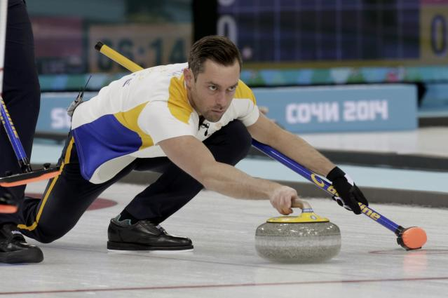 Sweden's vice Sebastian Kraupp delivers a stone during their men's curling round robin game against Switzerland at the Sochi Olympics in the Ice Cube Curling Center in Sochi February 10, 2014. REUTERS/Ints Kalnins (RUSSIA - Tags: OLYMPICS SPORT CURLING)