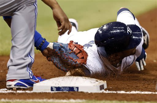 Tampa Bay Rays' Desmond Jennings is tagged out on a pickoff by Toronto Blue Jays first baseman Edwin Encarnacion during the second inning of a baseball game, Thursday, May 9, 2013, in St. Petersburg, Fla. (AP Photo/Mike Carlson)
