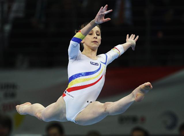 BERLIN, GERMANY - APRIL 10: Diana Maria Chelaru od Romania performs on the floor during the European Championships Artistic Gymnastics Women's Apparatus Finals at Max-Schmeling Hall on April 10, 2011 in Berlin, Germany. (Photo by Joern Pollex/Bongarts/Getty Images)
