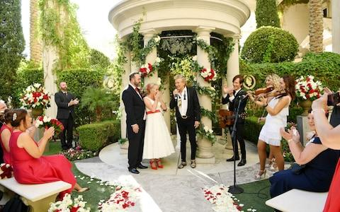 Sir Rod Stewart (R) sings during the wedding of Sharon Cook (C) and Andrew Aitchison - Credit: Denise Truscello