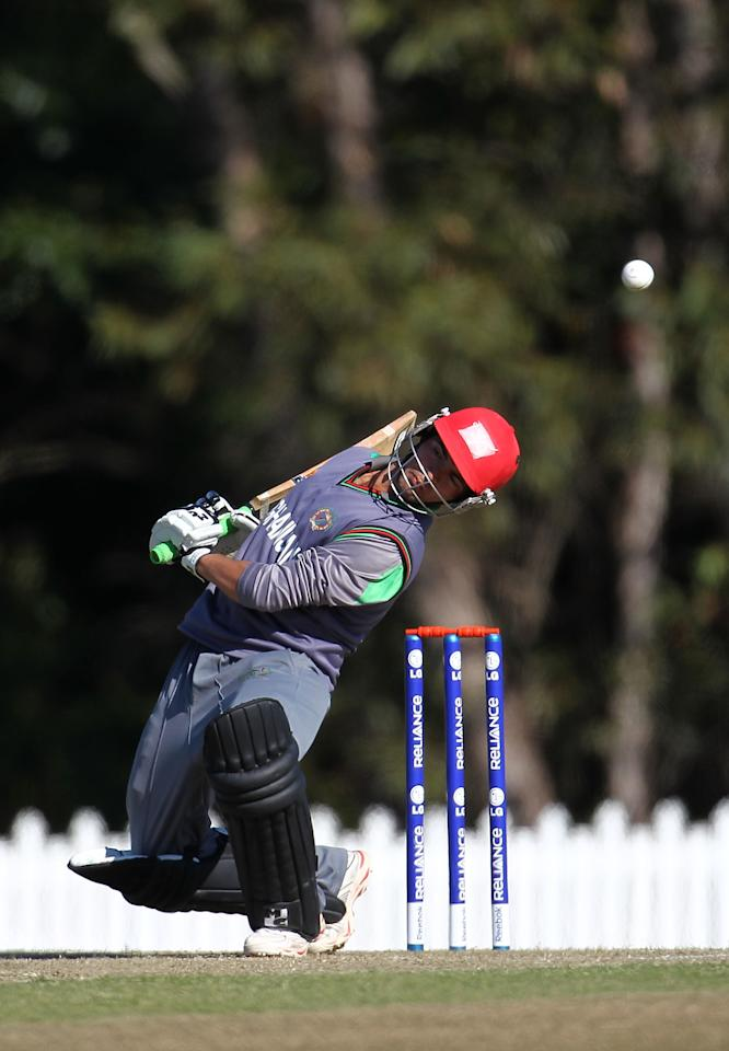 SUNSHINE COAST, AUSTRALIA - AUGUST 11:  Shabir Ahmed of Afghanistan ducks a bouncer during the ICC U19 Cricket World Cup 2012 match between Pakistan and Afghanistan at John Blanck Oval on August 11, 2012 in Sunshine Coast, Australia.  (Photo by Graham Denholm-ICC/Getty Images)