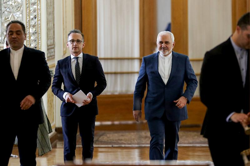 Iran's Foreign Minister Mohammad Javad Zarif (C-R) escorts his German counterpart Heiko Maas (C-L) to a joint news conference in the capital Tehran