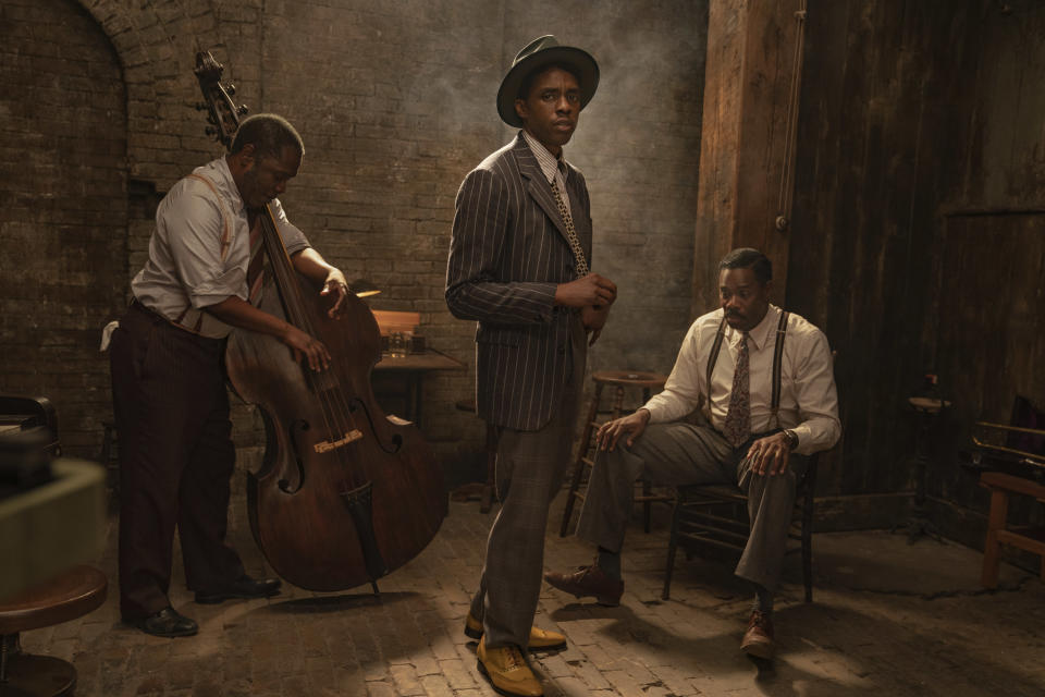 "This image released by Netflix shows Michael Potts, from left, Chadwick Boseman and Colman Domingo in ""Ma Rainey's Black Bottom."" (David Lee/Netflix via AP)"
