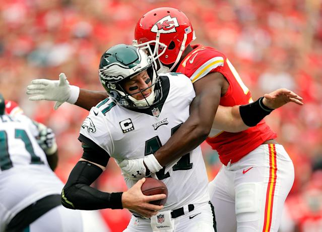 <p>Quarterback Carson Wentz #11 of the Philadelphia Eagles is sacked by outside linebacker Dee Ford #55 of the Kansas City Chiefs during the 1st half of the game at Arrowhead Stadium on September 17, 2017 in Kansas City, Missouri. (Photo by Jamie Squire/Getty Images) </p>