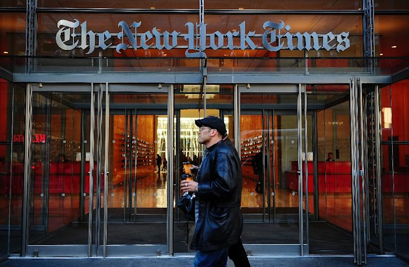 The New York Times, among the most aggressive in shifting to digital news, acknowledged recently that 70 percent of its revenues come from print (AFP Photo/Emmanuel Dunand)