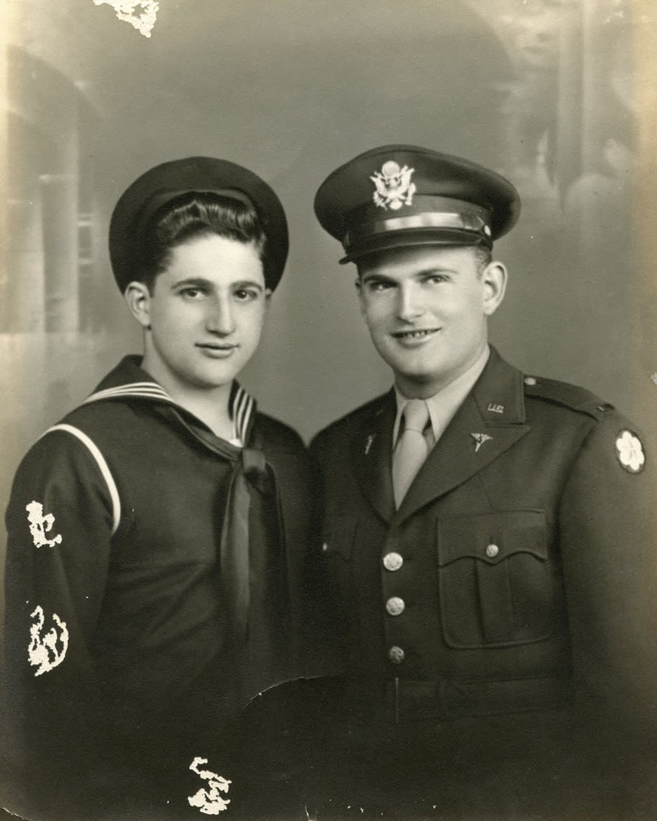 This November 1943 photo provided by his family shows shows Robert Fleury, left, and his brother Ed in their military uniforms. Robert served in World War II and parlayed the skills he learned in the war into a decades-long career with the National Weather Service. He died of complications from the COVID-19 coronavirus at a veteran's home in Scarborough in his longtime home state of Maine at the age of 94 on April 21, 2020. (Family photo via AP)
