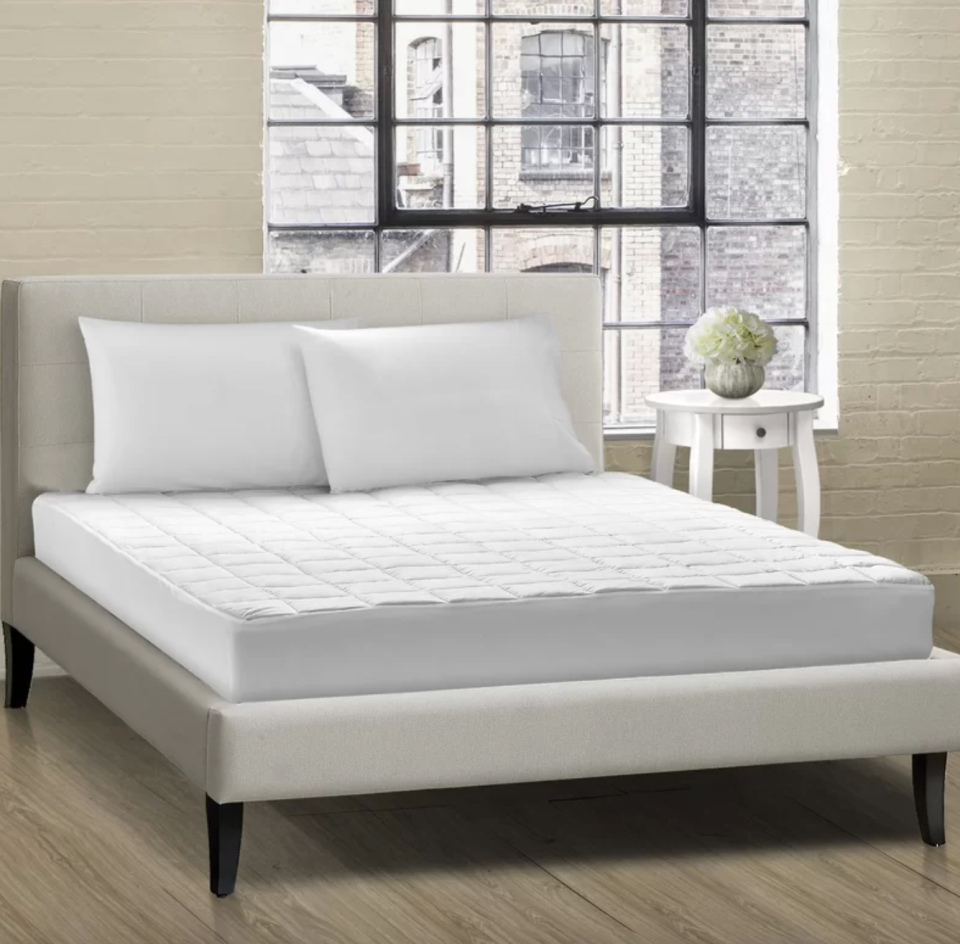 All Season Cloud Comfort Box Quilt Mattress Pad (Photo via Wayfair)