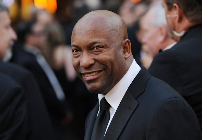 In this Feb. 24, 2008 file photo, director John Singleton arrives at the 80th Academy Awards in Los Angeles. Oscar-nominated filmmaker John Singleton has died at 51, according to statement from his family, Monday, April 29, 2019. He died Monday after suffering a stroke almost two weeks ago.