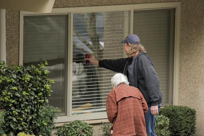 Dorothy Campbell and her son, Charlie Campbell, talk through a window with her husband, Gene Campbell, at the Life Care Center of Kirkland, the long-term care facility linked to several confirmed coronavirus cases in the state, in Kirkland, Washington, U.S. March 5, 2020. REUTERS/David Ryder