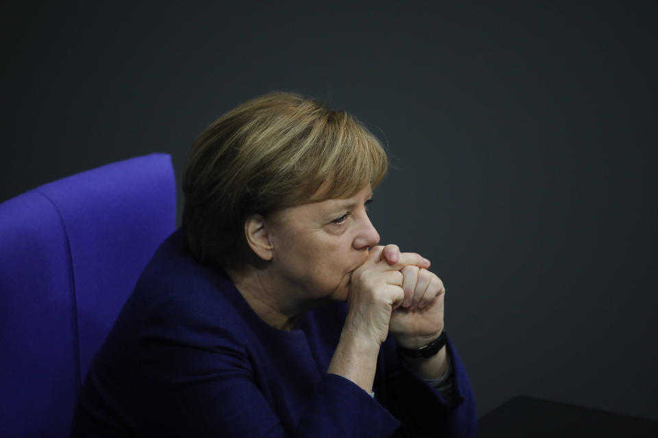 File - In this Tuesday, Dec. 8, 2020 file photo, German Chancellor Angela Merkel attends the debate about Germany's budget 2021, at the parliament Bundestag in Berlin, Germany. German Chancellor Angela Merkel's center-right party, the Christian Democratic Union, CDU, is choosing a new leader on the weekend Saturday Jan. 16 and Sunday Jan. 17, 2021, a decision that will help determine who succeeds Merkel at the helm of the European Union's biggest economy after a 16-year reign. Merkel, now 66, has steered Germany, and Europe, through a series of crises since she took office in 2005, she said over two years ago that she won't seek a fifth term as chancellor. (AP Photo/Markus Schreiber, file)