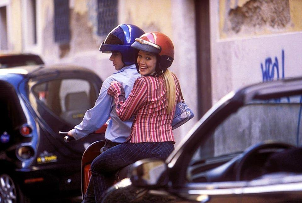 <p>This is what denim dreams are made of. While Hilary Duff stunned in plenty of early '00s looks in <em>The Lizzie McGuire Movie</em>, one scene that really stands out is her zipping through the streets of Italy in dark jeans and this striped top. </p>