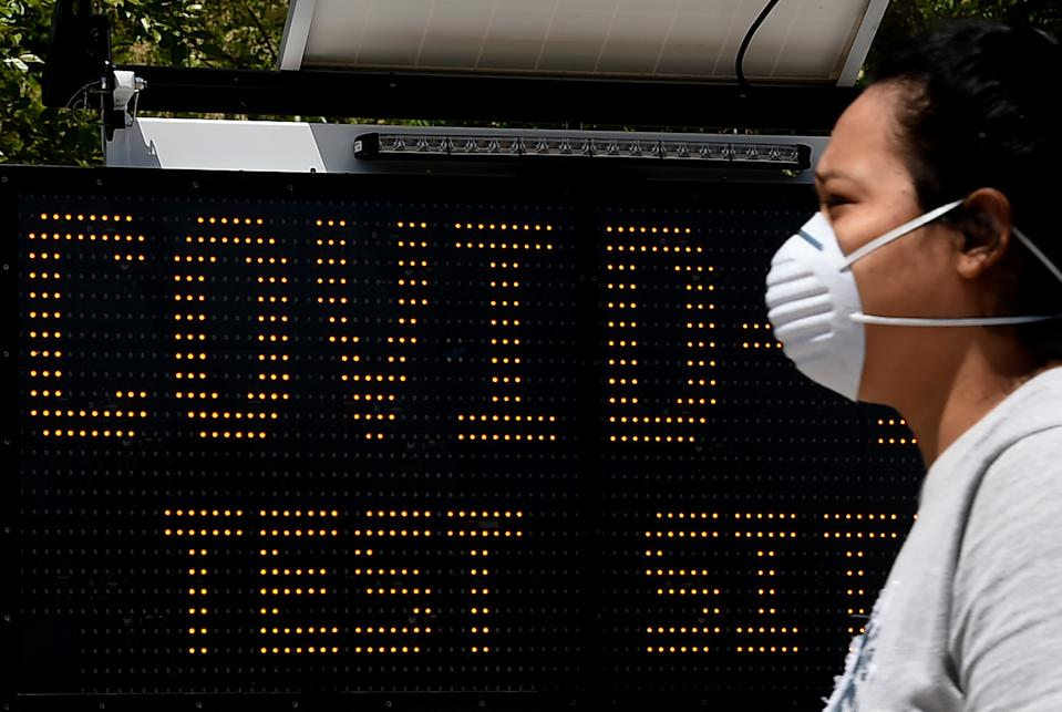 A patient walks-in at a Covid-19 testing site on May 12, 2020 in Arlington, Virginia. - Government epidemiologist Anthony Fauci stated, in testimony to US lawmakers, that even a cautious exit from the world's unprecedented economic shutdown could trigger a second coronavirus wave. Fauci admitted the true number killed by the epidemic in the US is likely higher than the official toll of 80,000 -- the world's highest. (Photo by Olivier DOULIERY / AFP) (Photo by OLIVIER DOULIERY/AFP via Getty Images)