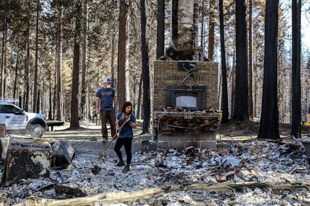 PHOTO: Caitlin Giannini and her fiance Josh Freis digs through the debris of their once standing home in Grizzly Flats, Calif., Sept. 12, 2021. (Bronte Wittpenn/San Francisco Chronicle via Polaris)