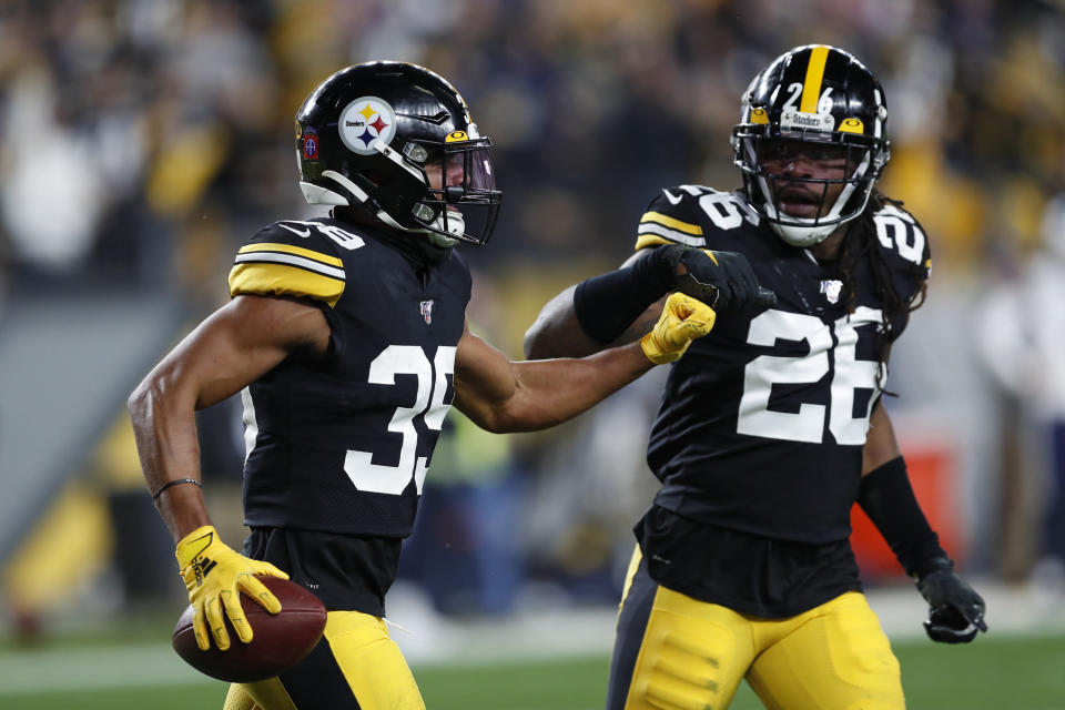 Pittsburgh Steelers free safety Minkah Fitzpatrick, left, celebrates with Mark Barron (26) after Fitzpatricks touchdown following the recovery of a fumble by Los Angeles Rams quarterback Jared Goff during the first half of an NFL football game in Pittsburgh, Sunday, Nov. 10, 2019. (AP Photo/Keith Srakocic)