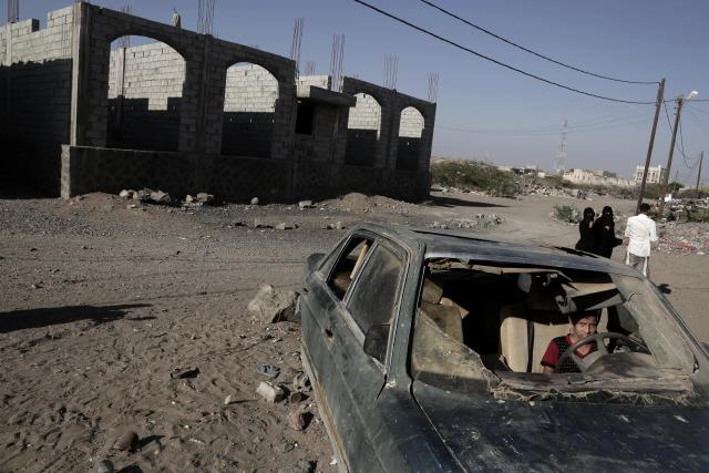 <p>In this Feb. 10, 2018 photo, a boy sits in a damaged car in Mocha, Yemen. (Photo: Nariman El-Mofty/AP) </p>