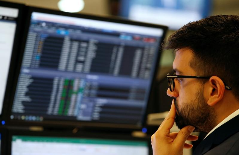 FTSE dips on murky trade view; Tullow tanks on mid-caps