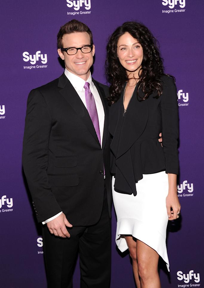 "Eddie McClintock and Joanne Kelly (""<a href=""http://tv.yahoo.com/warehouse-13/show/39506"">Warehouse 13</a>"") attend Syfy's 2012 Upfront event at the American Museum of Natural History on April 24, 2012 in New York City."