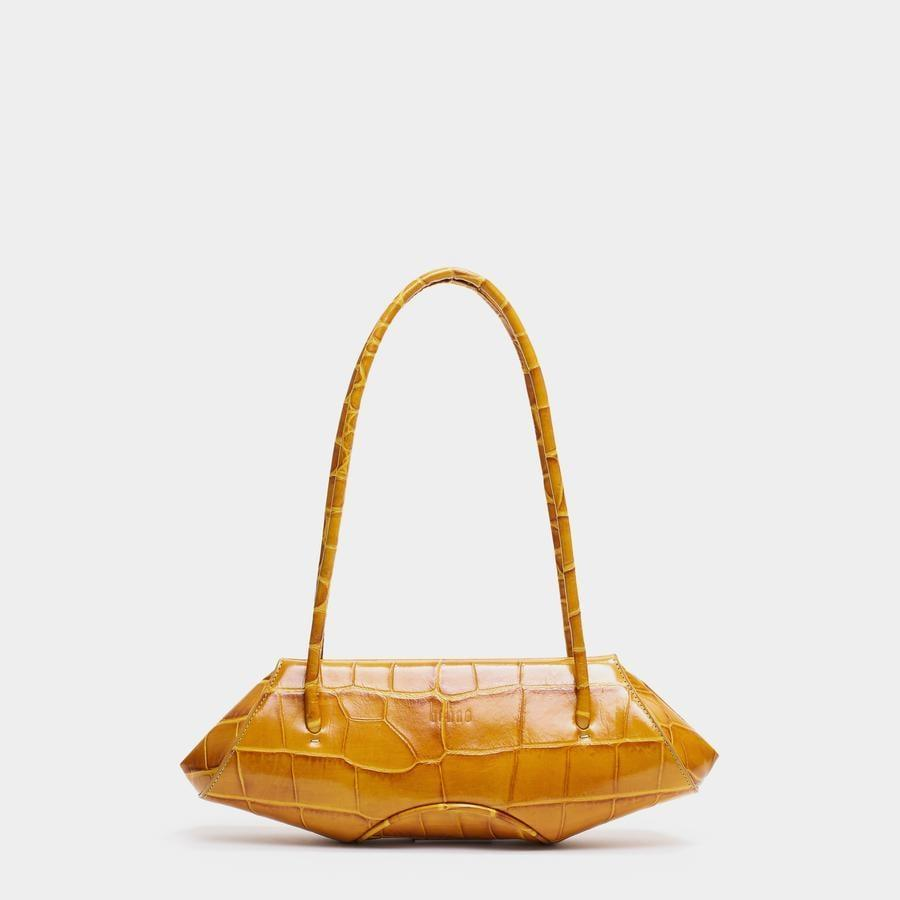 """<p>""""Eco-conscious brand Behno knows what it's doing when it comes to handbags. Just look at this <span>Behno Elizabeth Baguette Bag</span> ($490)!"""" - NC</p>"""