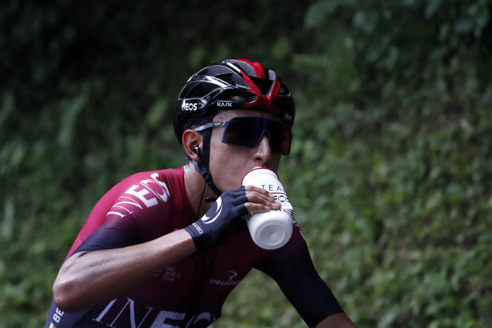 Colombia's Egan Arley Bernal Gomez resupplies during the sixth stage of the Tour de France cycling race over 160 kilometers (100 miles) with start in Mulhouse and finish in La Planche des Belles Filles, France, Thursday, July 11, 2019. (AP Photo/Christophe Ena)