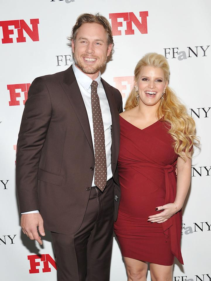 NEW YORK, NY - FILE:  Former professional football player Eric Johnson (L) and recording artist/actress Jessica Simpson attend the 25th Annual Footwear News Achievement Awards at the Museum of Modern Art on November 29, 2011 in New York City. Simpson and fiance Johnson gave brith to a baby girl, Maxwell Drew Johnson, on May 1, 2012 in Los Angeles, California.   (Photo by Mike Coppola/Getty Images)