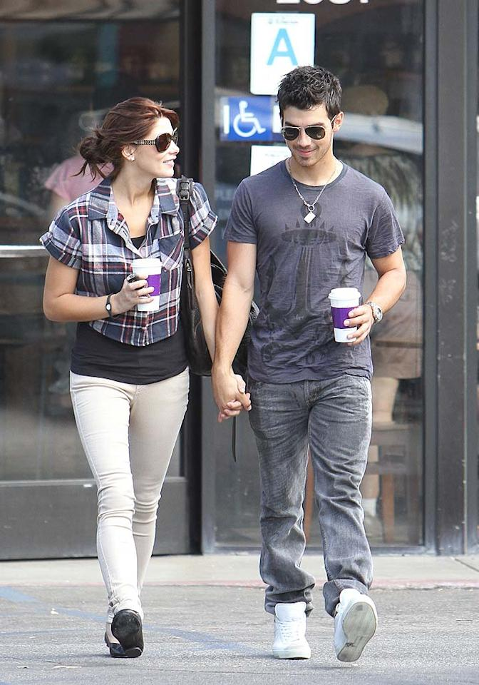 """Celebuzz reports Joe Jonas is """"so smitten"""" with his beautiful """"Twilight"""" girlfriend Ashley Greene that """"he's planning to pop the question."""" The website says Jonas has """"even gone ring-shopping on Beverly Hills' famed Rodeo Drive, looking for just the right rock to slip onto Greene's finger."""" So when will Jonas ask Greene to marry him? For the answer, click over to <a href=""""http://www.gossipcop.com/joe-jonas-diamond-ring-shopping-proposing-pop-question-ashley-greene-twilight/"""" target=""""new"""">Gossip Cop</a>. Dikran Djrdrjan/<a href=""""http://www.splashnewsonline.com"""" target=""""new"""">Splash News</a> - September 29, 2010"""