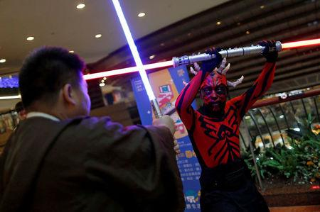 """Fans dressed as the characters from """"Star Wars"""" react during Star Wars Day in Taipei, Taiwan May 4, 2017. REUTERS/Tyrone Siu"""