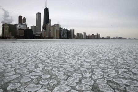 The Chicago skyline is seen above a partially frozen Lake Michigan in Chicago, Illinois, January 5, 2015. REUTERS/Jim Young