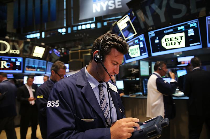 Traders work on the floor of the New York Stock Exchange (NYSE) on July 14, 2014 in New York City