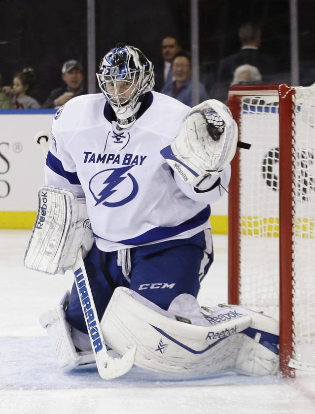 Tampa Bay Lightning goalie Ben Bishop (30) stops a shot on goal during the second period of an NHL hockey game against the New York Rangers, Tuesday, Jan. 14, 2014, in New York. (AP Photo/Frank Franklin II)