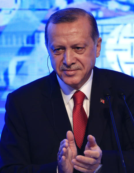 "Turkey's President Recep Tayyip Erdogan, applauds the organisers after delivering a speech at an Atlantic Council event in Istanbul, Friday, April 28, 2017. Erdogan said he sees ""signs that Mr. (US President Donald)Trump will exhibit a more decisive stance than the previous administration in terms of combatting terror.""Erdogan and Trump are scheduled to meet on May 16 in Washington.(AP Photo/Lefteris Pitarakis)"