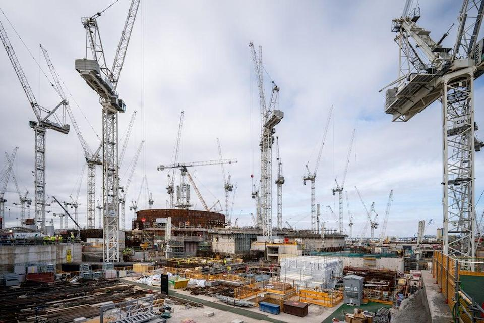 Cranes and scaffold surround the steel and reinforced concrete, partially built dome (Ben Birchall/PA) (PA Wire)