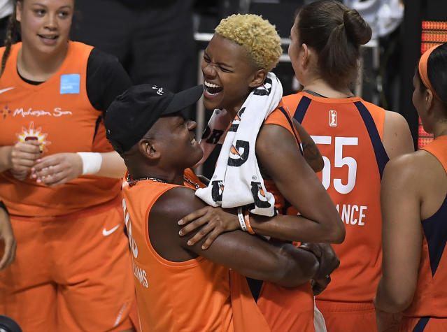 """<a class=""""link rapid-noclick-resp"""" href=""""/wnba/teams/con"""" data-ylk=""""slk:Connecticut Sun"""">Connecticut Sun</a>'s <a class=""""link rapid-noclick-resp"""" href=""""/wnba/players/5618/"""" data-ylk=""""slk:Courtney Williams"""">Courtney Williams</a> and her father Don Williams were the highlight of game 2. (AP Photo/Jessica Hill)"""