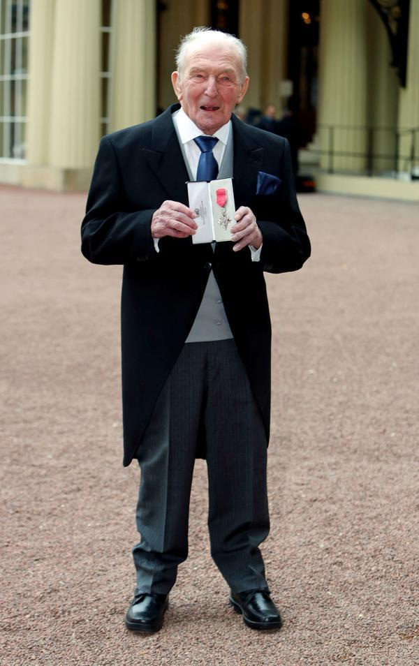 <strong>Johnny Johnson has collected an MBE from the Queen</strong>