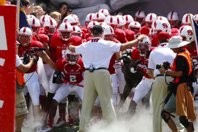 Two N.C. State coaches save woman from flipped car (Photo)