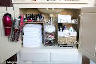 """<p>But with a little attention to detail, it now serves as a linen closet <em>and</em> bathroom essentials storage unit. Fresh linens are tucked under a shelf that holds nail polish, while hair tools hang from the door. </p><p><em><a href=""""http://www.livinglocurto.com/2015/03/bathroom-organization-ideas/"""" rel=""""nofollow noopener"""" target=""""_blank"""" data-ylk=""""slk:See more at Living Locurto »"""" class=""""link rapid-noclick-resp"""">See more at Living Locurto »</a></em></p><p><strong>What you'll need: </strong><span class=""""redactor-invisible-space"""">storage drawers, $25, <a href=""""https://www.amazon.com/Halter-Storage-Drawers-Baskets-Bathroom/dp/B072F3GL18/?tag=syn-yahoo-20&ascsubtag=%5Bartid%7C10063.g.36078080%5Bsrc%7Cyahoo-us"""" rel=""""nofollow noopener"""" target=""""_blank"""" data-ylk=""""slk:amazon.com"""" class=""""link rapid-noclick-resp"""">amazon.com</a></span><br></p>"""
