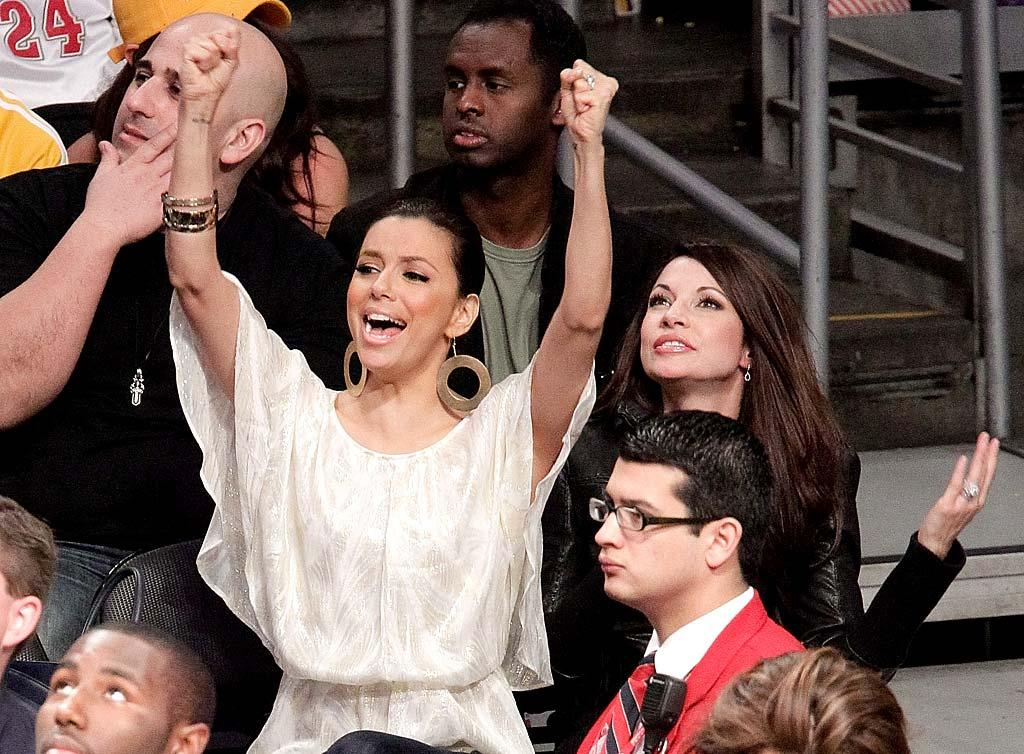 "Kim's BFF, Eva Longoria Parker, was also at the game to cheer on the rival Spurs. Even though Eva's hubby, Tony Parker, was sidelined with a hand injury, his team emerged victorious. Noel Vasquez/<a href=""http://www.gettyimages.com/"" target=""new"">GettyImages.com</a> - April 4, 2010"