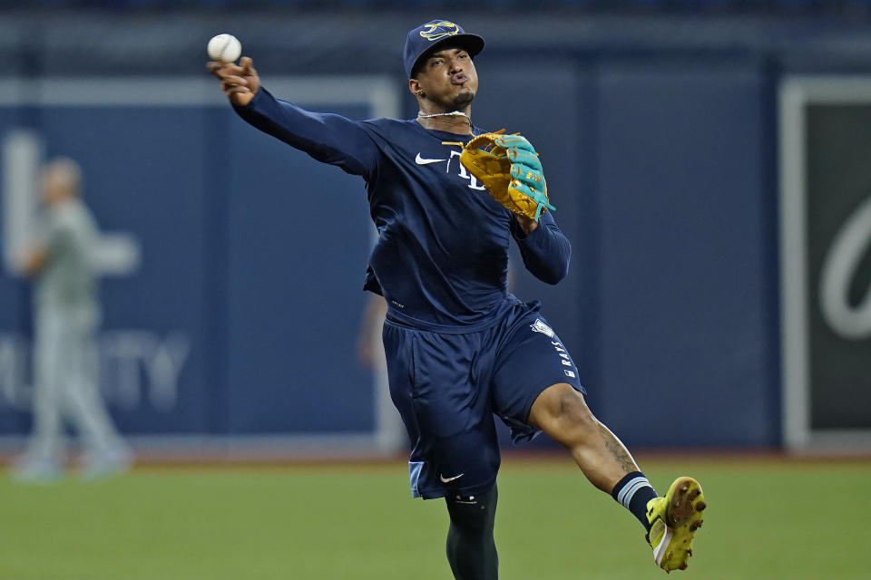 Tampa Bay Rays shortstop Wander Franco throws the ball during infield drills before a baseball game against the Toronto Blue Jays Monday, Sept. 20, 2021, in St. Petersburg, Fla. Franco expects to rejoin the team next week after injuring his hamstring. (AP Photo/Chris O'Meara)