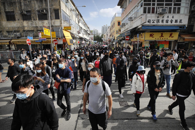 "Protesters march during a demonstration against ""parallel traders"" who buy goods in Hong Kong to resell in mainland China in Sheung Shui, near the Chinese border in Hong Kong, Sunday, Jan. 5, 2020. Protesters in Hong Kong marched through the border town Sunday to oppose traders from mainland China. (AP Photo/Andy Wong)"