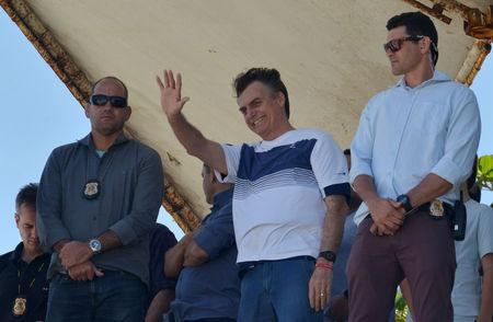 Brazil's new president-elect, Jair Bolsonaro, waves to supporters as he watches airplanes performing near his condominium at Barra da Tijuca neighbourhood in Rio de Janeiro