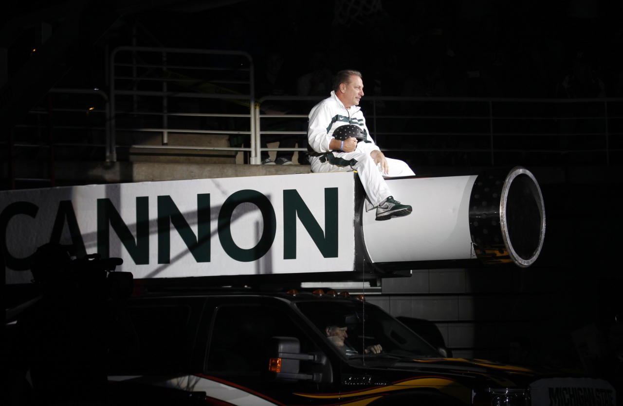 Michigan State coach Tom Izzo makes his entrance on top of a cannon before an NCAA college basketball scrimmage, Friday, Oct. 18, 2013, in East Lansing, Mich. (AP Photo/Al Goldis)
