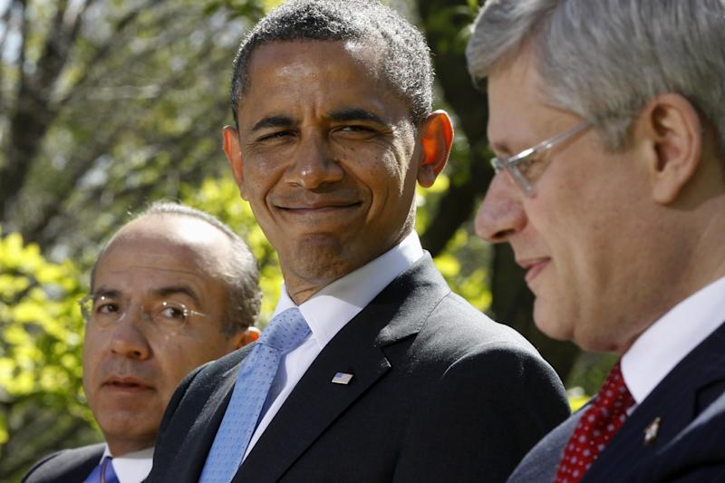 President Barack Obama, Mexico's President Felipe Calderon, and Canada's Prime Minister Stephen Harper participate in a joint news conference in the Rose Garden at the White House in Washington, Monday, April 2, 2012. (AP Photo/Charles Dharapak)