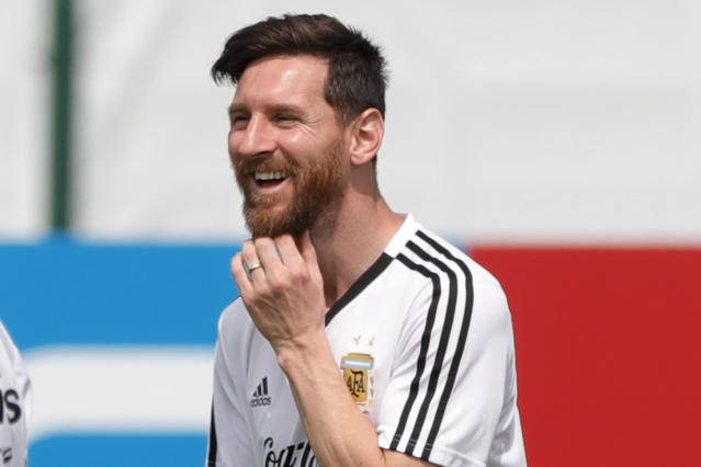 Lionel Messi smiles during a training session of Argentina at the 2018 soccer World Cup in Bronnitsy, Russia, Sunday, June 24, 2018. (AP Photo/Ricardo Mazalan)