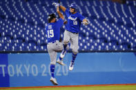 Israel's Danny Valencia celebrates with coach Nate Fish after hitting a two run home run during the eight inning of a baseball game against the Dominican Republicat the 2020 Summer Olympics, Tuesday, Aug. 3, 2021, in Yokohama, Japan. (AP Photo/Matt Slocum)