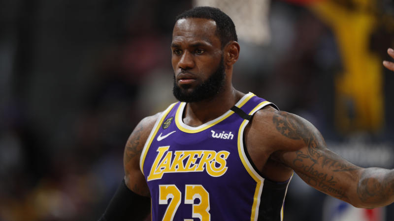 LeBron James is open to creative ways to play during the shutdown, but can't imagine how it would feel without fans. (AP Photo/David Zalubowski)