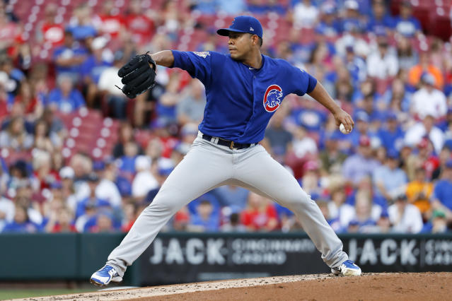 Chicago Cubs starting pitcher Jose Quintana throws during the first inning of the team's baseball game against the Cincinnati Reds, Friday, June 22, 2018, in Cincinnati. (AP Photo/John Minchillo)