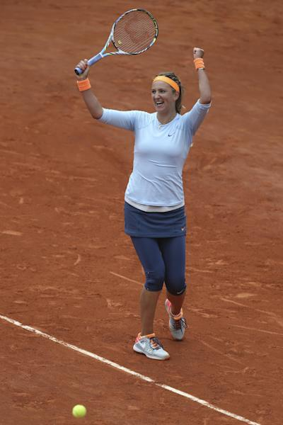 Victoria Azarenka of Belarus celebrates as the ball goes out, defeating Italy's Francesca Schiavone in two sets 6-3, 6-0, their fourth round match at the French Open tennis tournament, at Roland Garros stadium in Paris, Monday June 3, 2013. (AP Photo/Michel Euler)