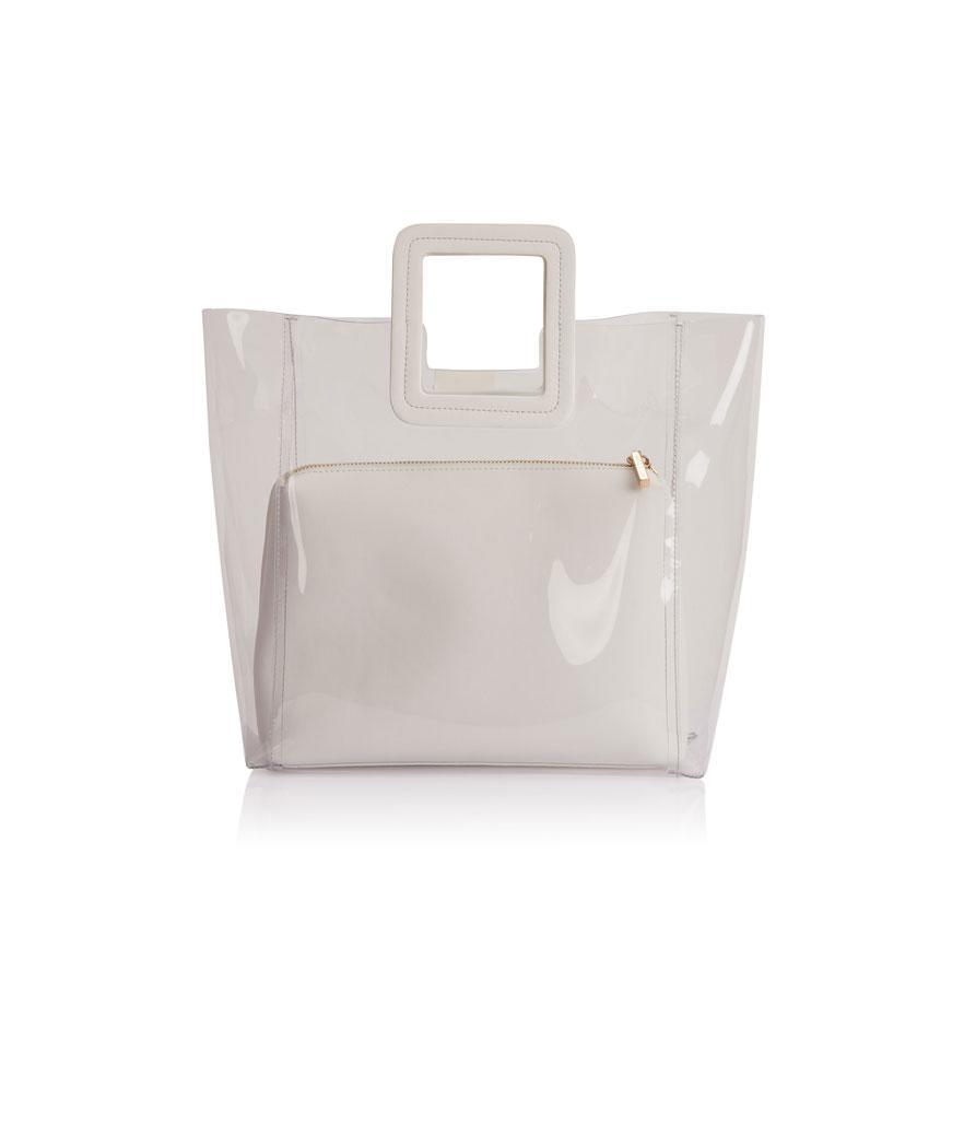 """<p><span>PVC and Leather Shirley Tote Bag, $210, <a rel=""""nofollow noopener"""" href=""""https://fivestoryny.com/products/shirley-pvc-tote-in-white"""" target=""""_blank"""" data-ylk=""""slk:fivestory.com"""" class=""""link rapid-noclick-resp"""">fivestory.com </a></span> </p>"""