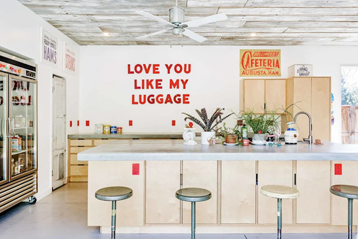The kitchen area inside the shipping container home is all about simplicity, with the occasional quirky decor piece standing out here and there.