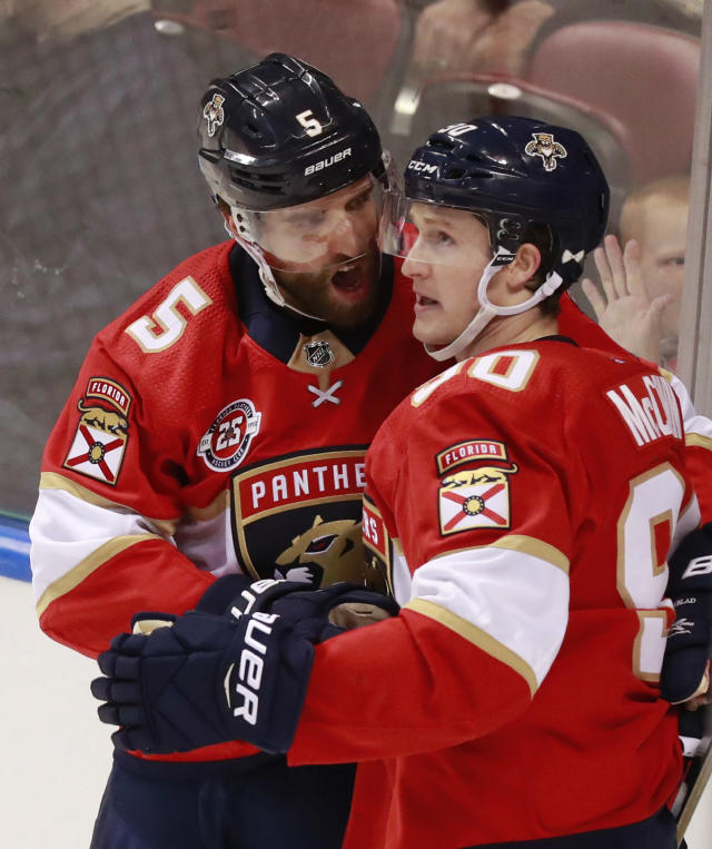Florida Panthers defenseman Aaron Ekblad (5) celebrates with center Jared McCann (90) after scoring a goal during the second period of an NHL hockey game against the Colorado Avalanche, Thursday, Dec. 6, 2018, in Sunrise, Fla. (AP Photo/Wilfredo Lee)